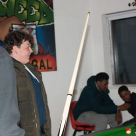 Playing pool and catching up with friends