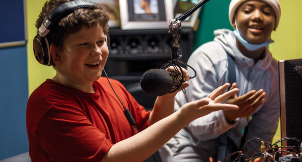 Boys-in-radio-studio-laughing